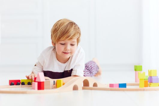 A young boy playing wwith blocks