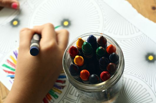 A child colouring with crayons